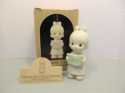 "PRECIOUS MOMENTS  "" Wishing You a Merry Christmas"" ornament E-5387 dated 1984"