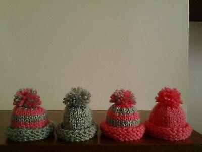 4 Hand Knitted Egg Cosies..