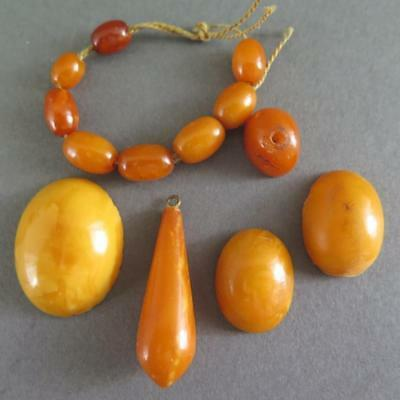 Group Of Antique Egg Yolk Amber Beads And Pendants And Cabochons [101]
