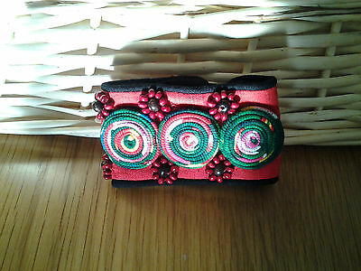 unusual purely hand-made cloth bracelet with wooden beads and crafted pattern