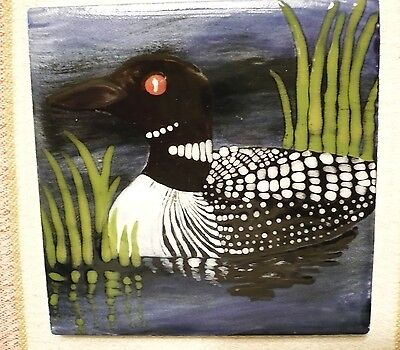 Hand-painted COMMON LOON tile.Excellent condition. Never used. Clean and bright.