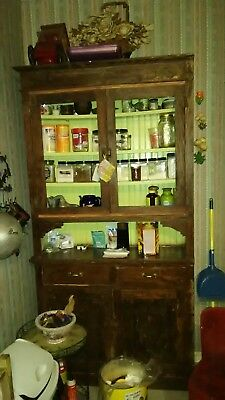 worn but fully functional antique kitchen cabinet with no glass panes