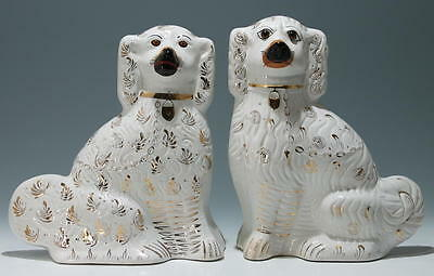 An Pair of Old Staffordshire Spaniels (different) 34 cm / (13 1/2 inch)