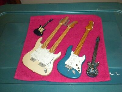 Five Miniature (2 Handcrafted) Collectable Guitars And One Stand. New! No More!