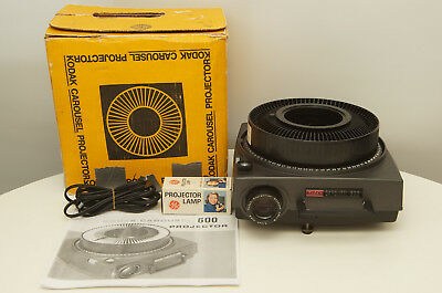 Kodak Carousel 600 Slide Projector with lens, tray, and extra bulb
