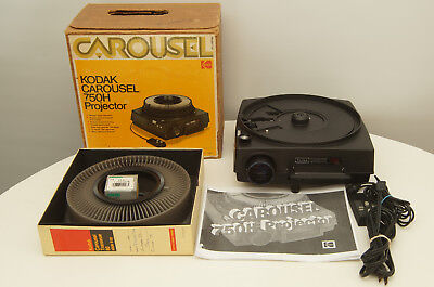 Kodak Carousel 750H Slide Projector with tray, remote, lens, and extra bulb