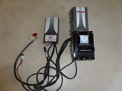 Bill changer validator with harness. American Changer.