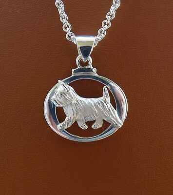 Sterling Silver Norwich Terrier Moving Study On A Oval Frame Pendant
