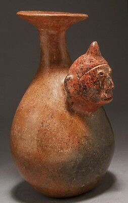 A Rare Pre-Columbian Colima Ceremonial Flask with the Head of a Shaman.