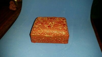 A Carved Cinnabar Lacquer Dragon Box And Hinged Cover