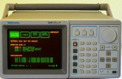TEKTRONIX TEK 1241 color logic analyzer with pods and many accessoires