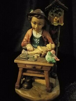 """Boy Woodworking At Table With Cuckoo Clock Hand Carved Painted Figurine 5"""""""