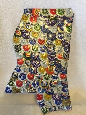 Folk art collage in the shape of Mississippi using beer bottle tops