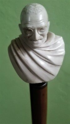 Antiques canes. Fist is a unique handcrafted antique piece depicting Gandhi.