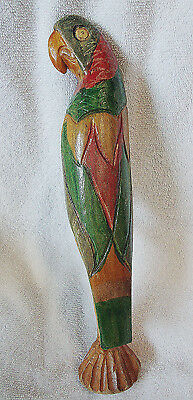 Wood Green & Red Parrot Sitting On Stick