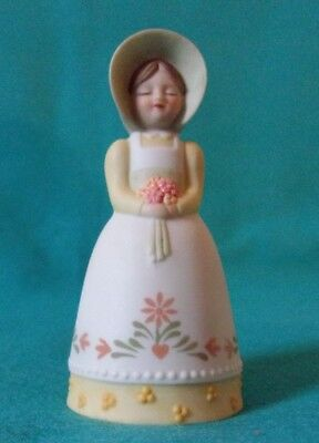 1985 Avon collectible bell. Porcelain girl with bonnet flowers