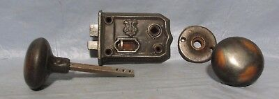 Set of vintage copper toned steel pressed door knobs with lock and cover plate