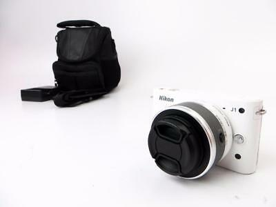 Nikon 1 J1 Mirrorless DSLR Digital Camera With 10-30mm lens - White