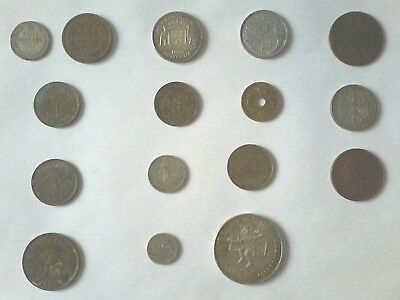 A lot of 16 very old coins from around the world.