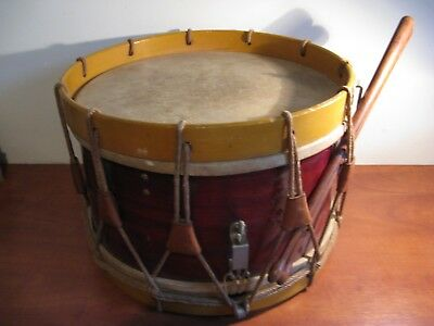 Large wooden antique drum ... with the drum sticks there.
