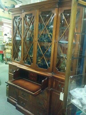 American mahogan flaming drop front desk with divided double-door bookcase