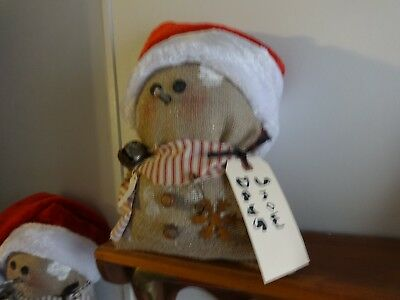 Handmade Burlap Snowman with rusty pins, bells and tags