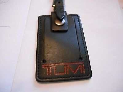 Tumi leather luggage tag black with red logo lettering business card tumi leather luggage tag black with red logo lettering business card size reheart Image collections