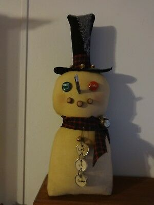 Handmade Primitive Snowman with bottle cap eyes, rusty pins, bells, coffee stain