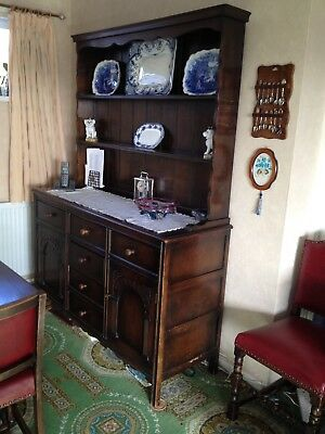 Dark oak dresser, solid wood with open shelves, three drawers and two cupboard