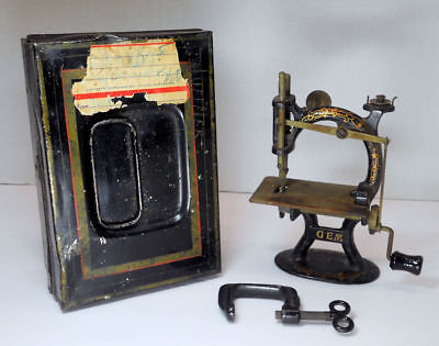 American Gem Antique Toy Sewing Machine with Case and Clamp