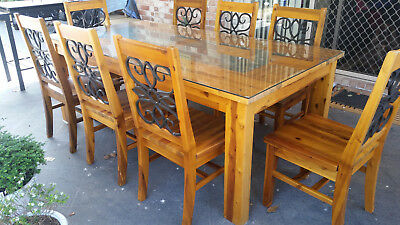 8 Seater Wooden, Wrought Iron and Glass Top Dining Setting.