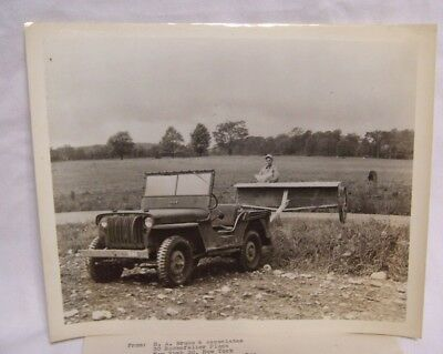 1950's Farmer Using Jeep to Fertilize Promotional Photo