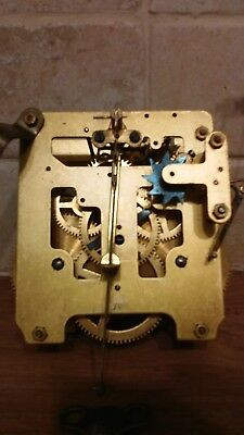 2 old/vintage clock movements for spares or repair with keys and hands