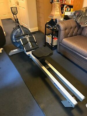 FluidRower E 316 water rowing machine with performance monitor and mat. Vgc