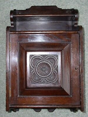Antique wall hanging cabinet, Victorian oak, small proportions with carved panel