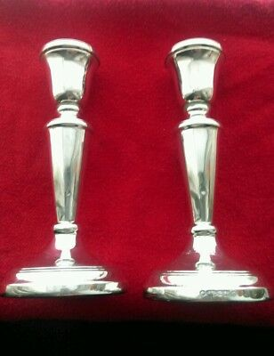 Pair of 14.5 cm hallmarked silver candle sticks. (Filled)