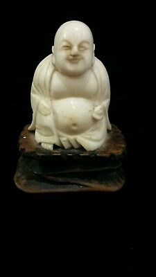 small antique  ivory  buddha
