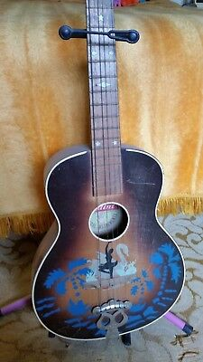 Old Bellini Antique guitar. Would be beautiful restored.