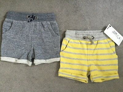 M&S SET OF 2 PAIRS OF SHORTS ONE GREY & ONE GREY/YELLOW STRIPED- 6-9m - BNWT