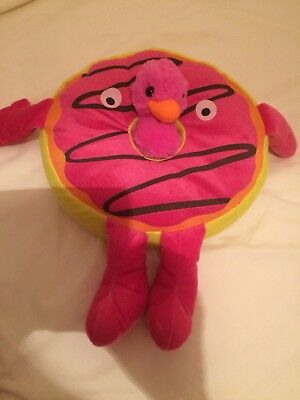 Novelty cushion children's room pink and yellow round with cuddly toy in centre