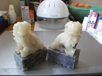 A Pair Of Chinese Jade Carved Temple Dogs On Soapstone Plinths