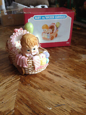 Ceramic Baby with Wicker Carriage - Girl