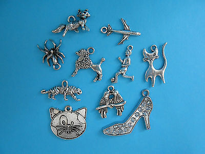Job Lot of 10 Mixed Silver Tibetan Charms Cat Footballer Fox Tiger Aeroplane etc