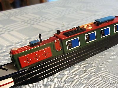 Model of Narrow Boat from England, 10 inches long by approxamately 2 inches tall