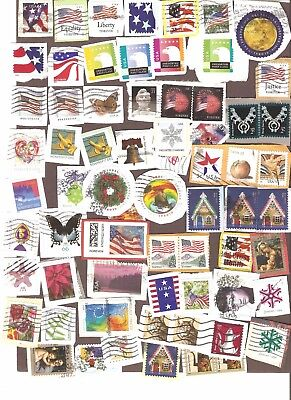 USA - 68 used stamps on paper