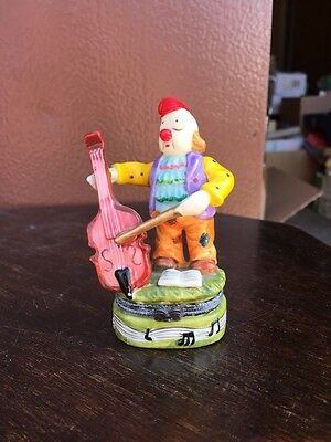 Clown Playing A Chello Figurine