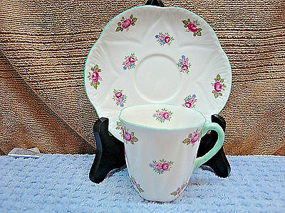 419 Shelley rosebud pattern white porcelain demitasse cup and saucer.