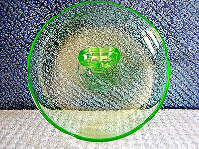 208 Green vaseline glass ash tray with heart shaped handle.