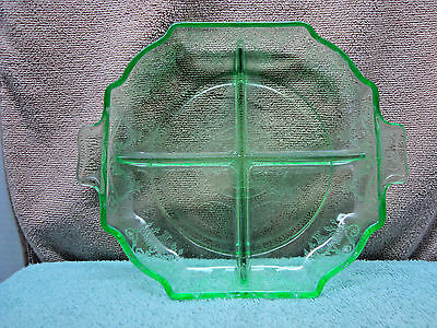 Four compartment green vaseline glass relish dish.