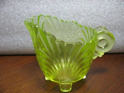 Green Vaseline Glass Creamer With Handle And Four Legs Glows With Blacklight